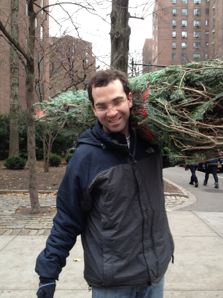 Brian carrying christmas tree